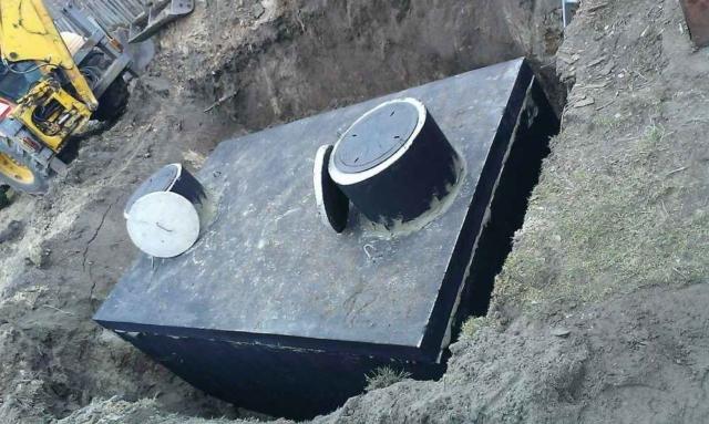 Usazení betonového septiku do výkopu